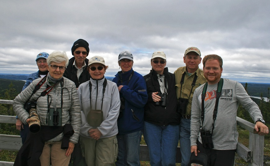 Our Eagle Eye Tour group, flanked by a beautiful vista in Terra Nova National Park.