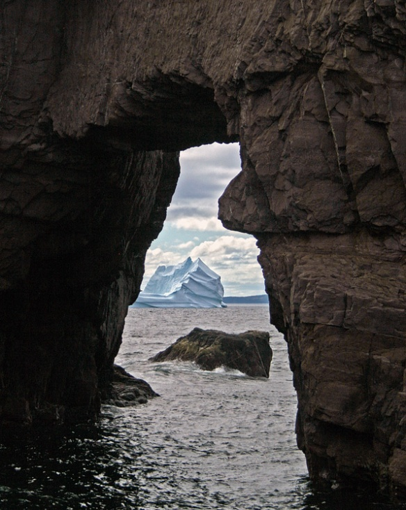 The sea arch at nearby Tickle Cove is always a beautiful sight, but especially when you can spot a massive iceberg through it!