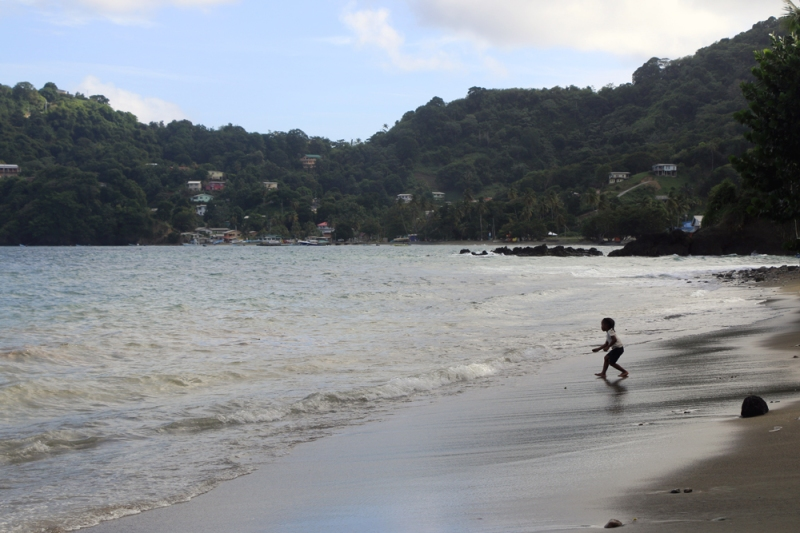 "Our ""base of operations"" on Tobago was a small beach resort at the island's northeast corner. Here, a child plays on the beach in the nearby village of Speyside."