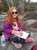 Leslie (8) making some nature notes during a family hike