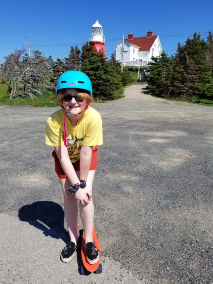 "Emma (11) enjoying her ""penny board"" at Long Point lighthouse, Twillingate"
